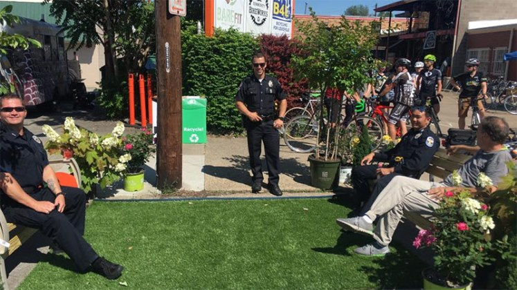 LMPD officers enjoying a Better Block parklet. (Courtesy Center for Neighborhoods)
