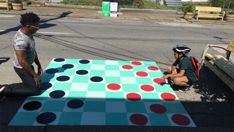 A game of checkers in the street. (Courtesy Center for Neighborhoods)