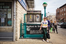 New York City, New York, USA - April 28, 2013:  Street corner scene from Brooklyn, New York City with subway entrance, payphone and people visible.  This image was photographed in Williamsburg section of Brooklyn.