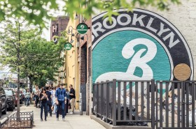 New York, USA - May 14, 2016: Exterior of one of the facilities of Brooklyn Brewery at Williamsburg - Brooklyn. The picture was taken on a saturday afternoon on springtime with the streets crowded of passersby and tourists, mostly young people.