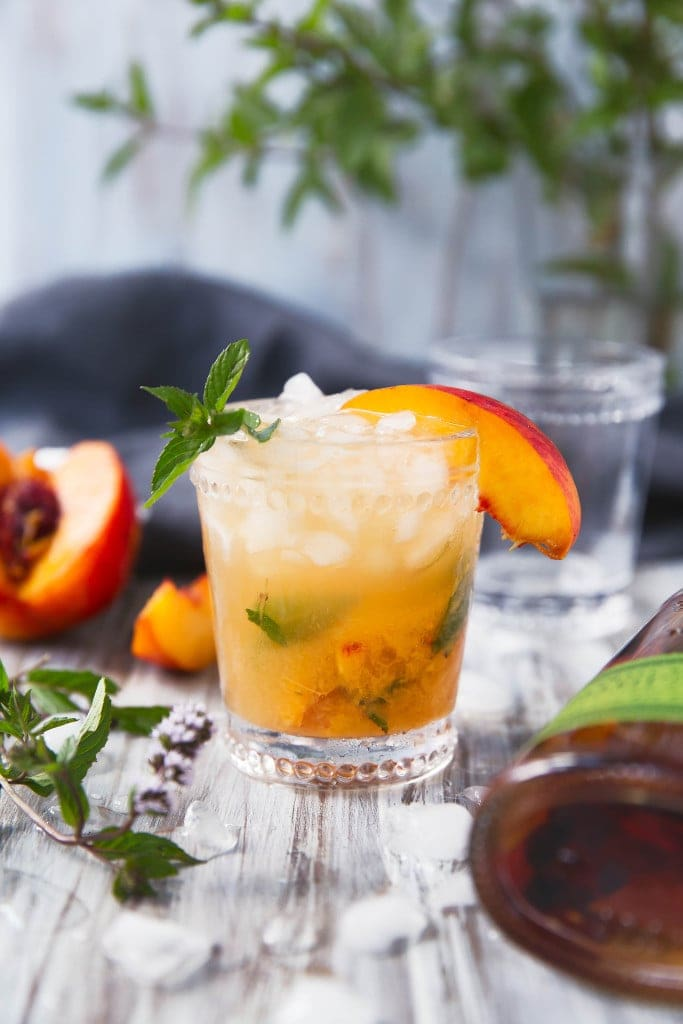 The classic mint julep gets a twist with this mouth-watering Peach Julep!