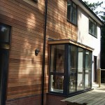 Side view of house with cedar cladding and aluminium windows