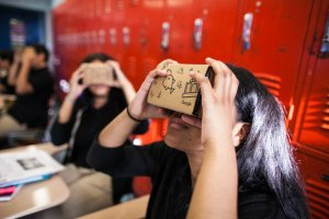 Students using Google Expeditions, via a cardboard viewer and a smartphone, at Bronx Latin High School in New York. Credit Andrew Federman/Bronx Latin High School (via the New York Times, September 28, 2015)