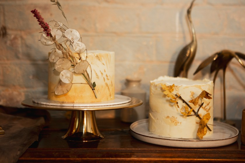 2 small gold and buttercream wedding cakes