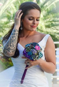 Medium Bouquet 6-8 inches across. Most popular among bride because most find the size is JUST RIGHT! Prices from $275.