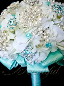 teal pool blue white ivory hydrangea broach bouquet