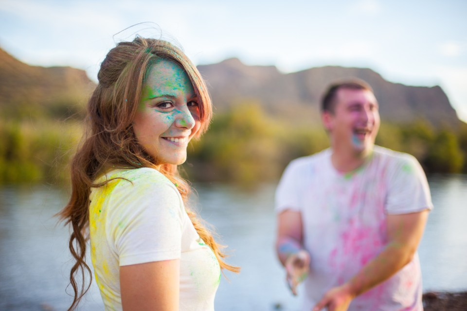 post color fight picture of couple with colored powder all over
