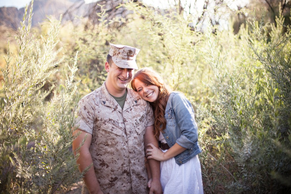 Laughing Military couple in desert foliage