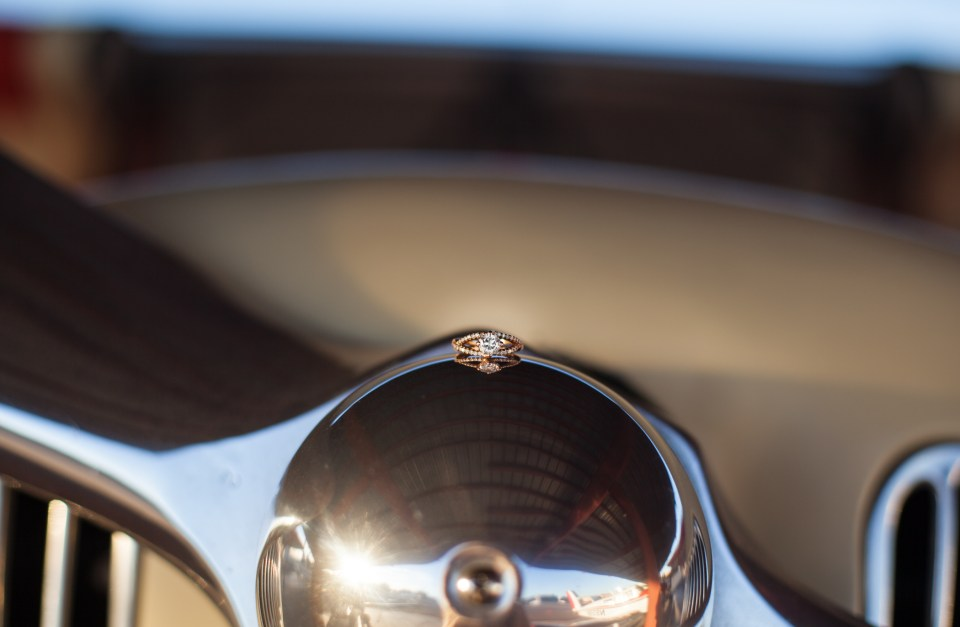 vintage rose gold diamond engagement ring on an airplane propeller