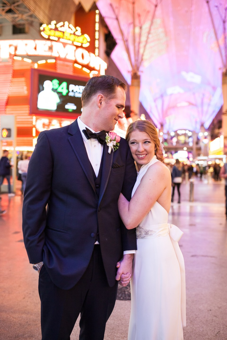 las vegas wedding bride and groom with vegas lights