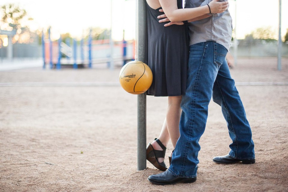 childhood sweethearts proposal story and playground engagement photos