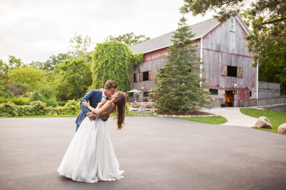 The Farm at Dover Milwaukee Wedding - Brooke & Doug Photography bride and groom dipping in front of barn