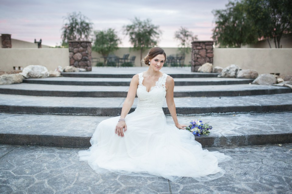 bride with v-neck a-line lace tattoo back wedding dress sitting on steps
