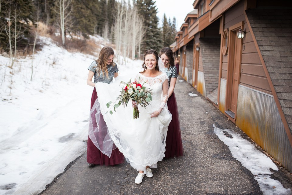 bride walking with bridesmaids, durango colorado winter wedding ideas