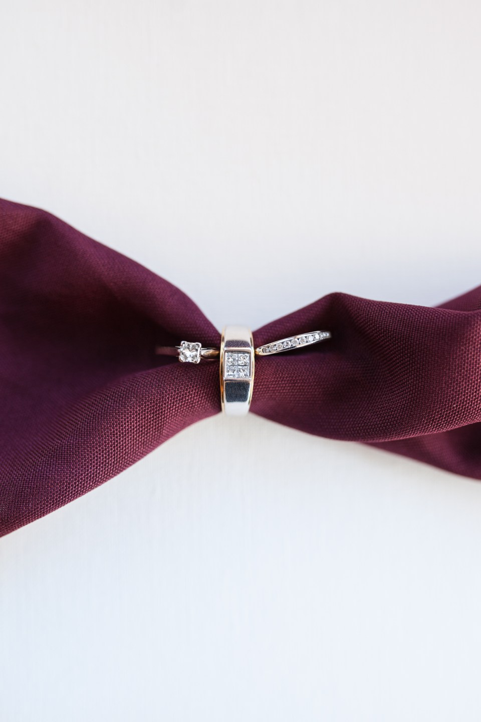 diamond engagement ring and wedding rings ring shot with merlot