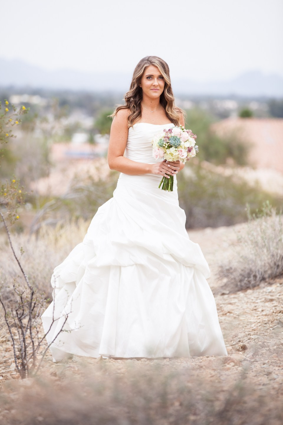 bride in semi sweetheart strapless ruffled wedding dress