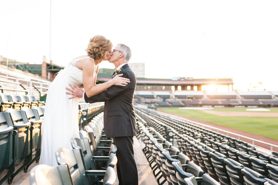 bride and groom in baseball stadium wedding