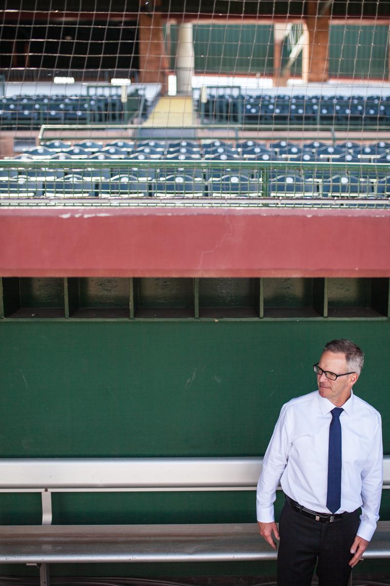 groom in dugout of baseball stadium