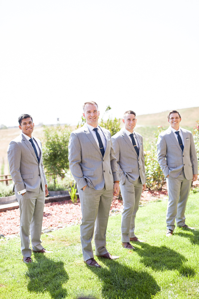 Groom and groomsmen in grey tuxedos