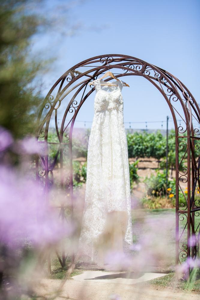 Lace sheath wedding dress with lace straps in temecula vineyard wedding
