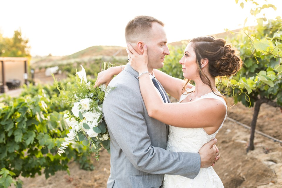 Temecula Winery Wedding bride and groom in Europa Village vineyard