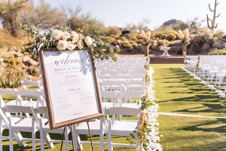 wedding ceremony florals on Welcome sign at desert ceremony