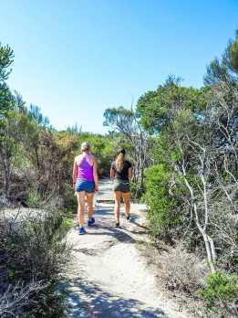 Diana & Maddy walking through the bush