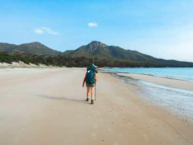 Walking across Hazards Beach to camp