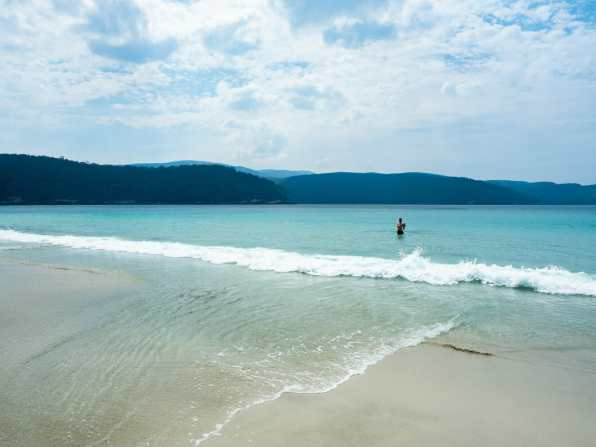 Going for a swim at Fortescue Bay