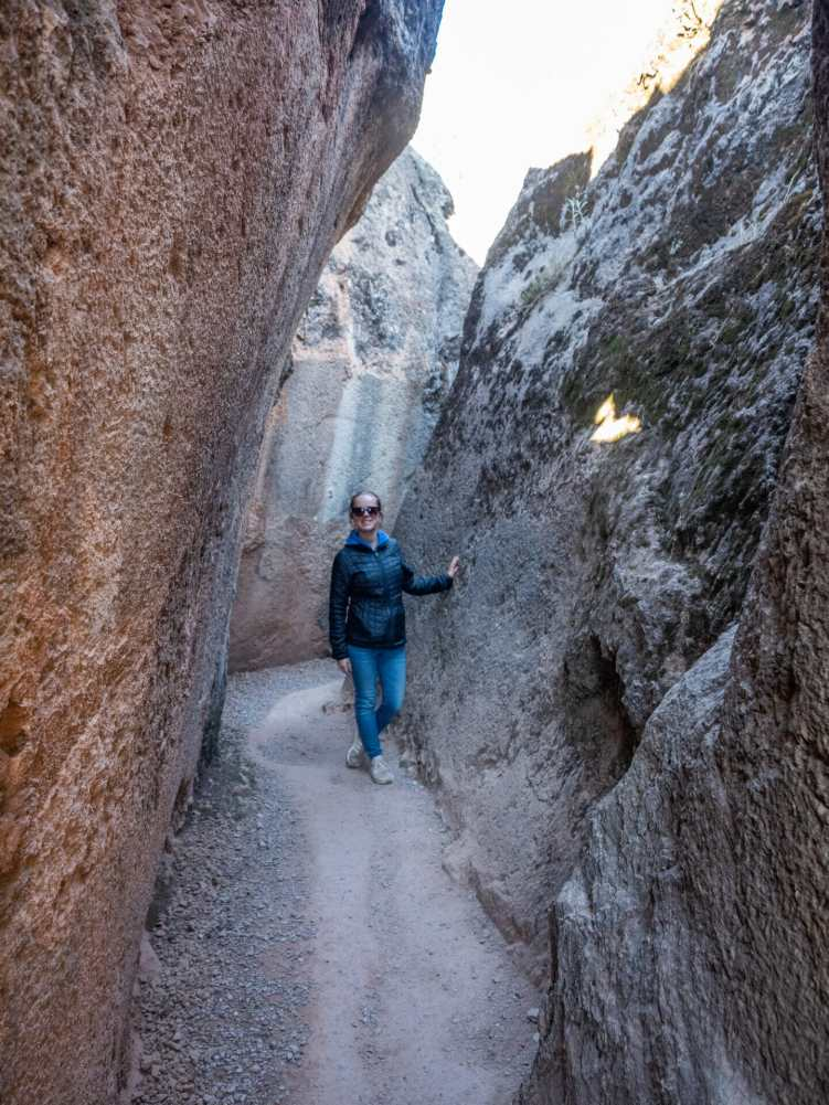 Inka walking through the caves at Q'enqo
