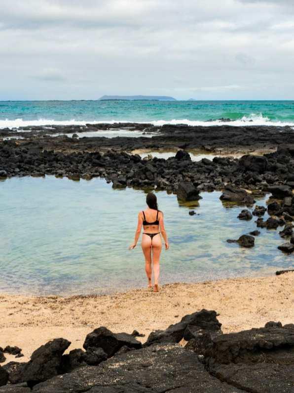 Girl in bikini walking on beach Playa del Amor