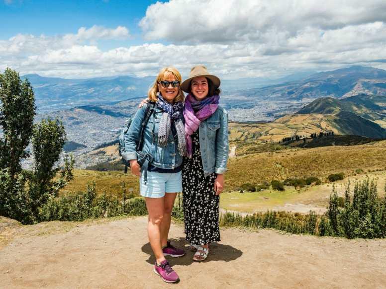 Women standing on Pichincha Volcano overlooking Quito