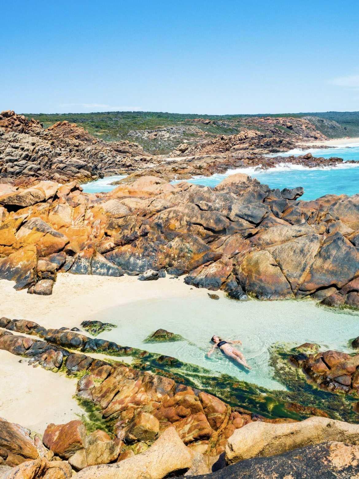 Girl laying in rockpool Injidup Natural Spa Western Australia
