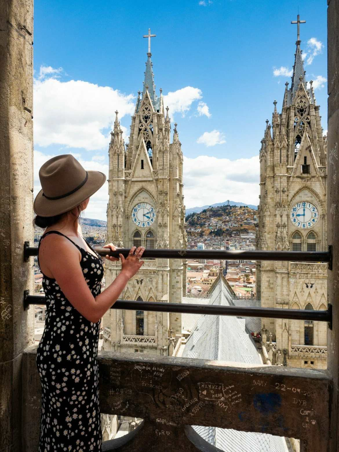 Girl looking at Basilica del Voto Nacional from tower in Quito