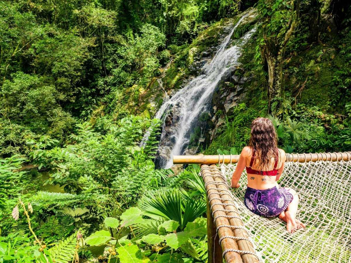 Girl sitting on hammock by Marinka Waterfall Minca Colombia
