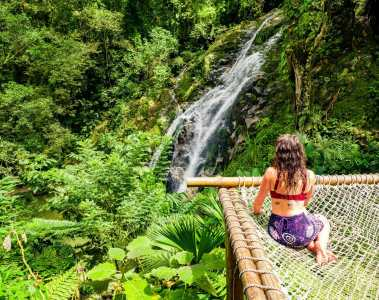 Girl sitting on hammock by Marinka Waterfall Minca Colombia