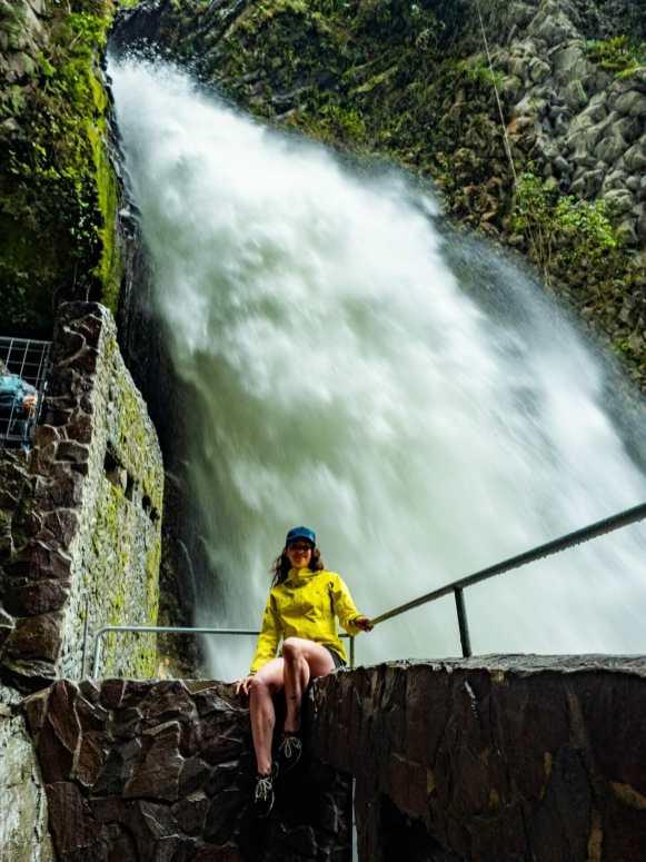 Girl at Paílón del Diablo waterfall Baños Ecuador