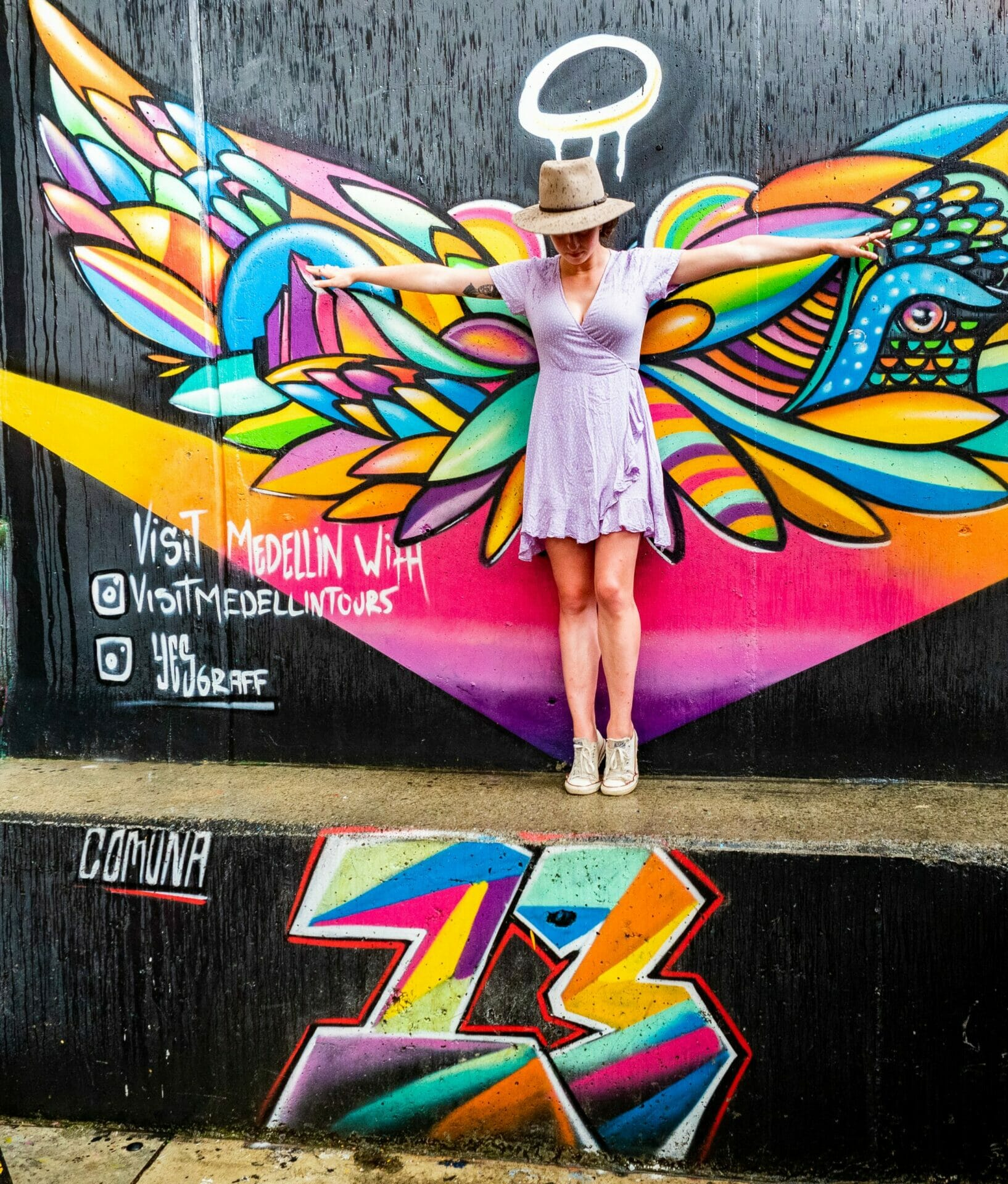 Graffiti street art angel wings Medellín Colombia