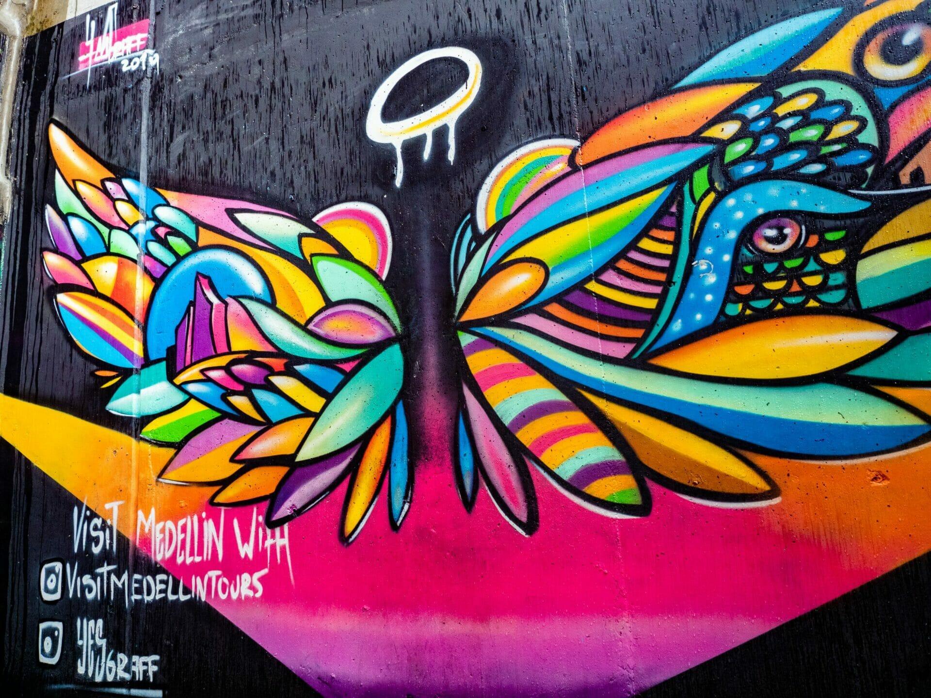Graffiti street art angel wings Medellín Colombia