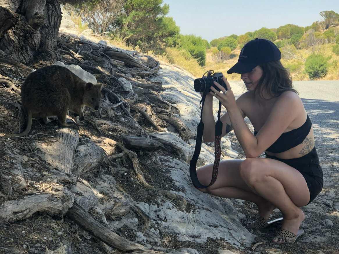 Girl photographing Quokka Rottnest Island Perth Western Australia