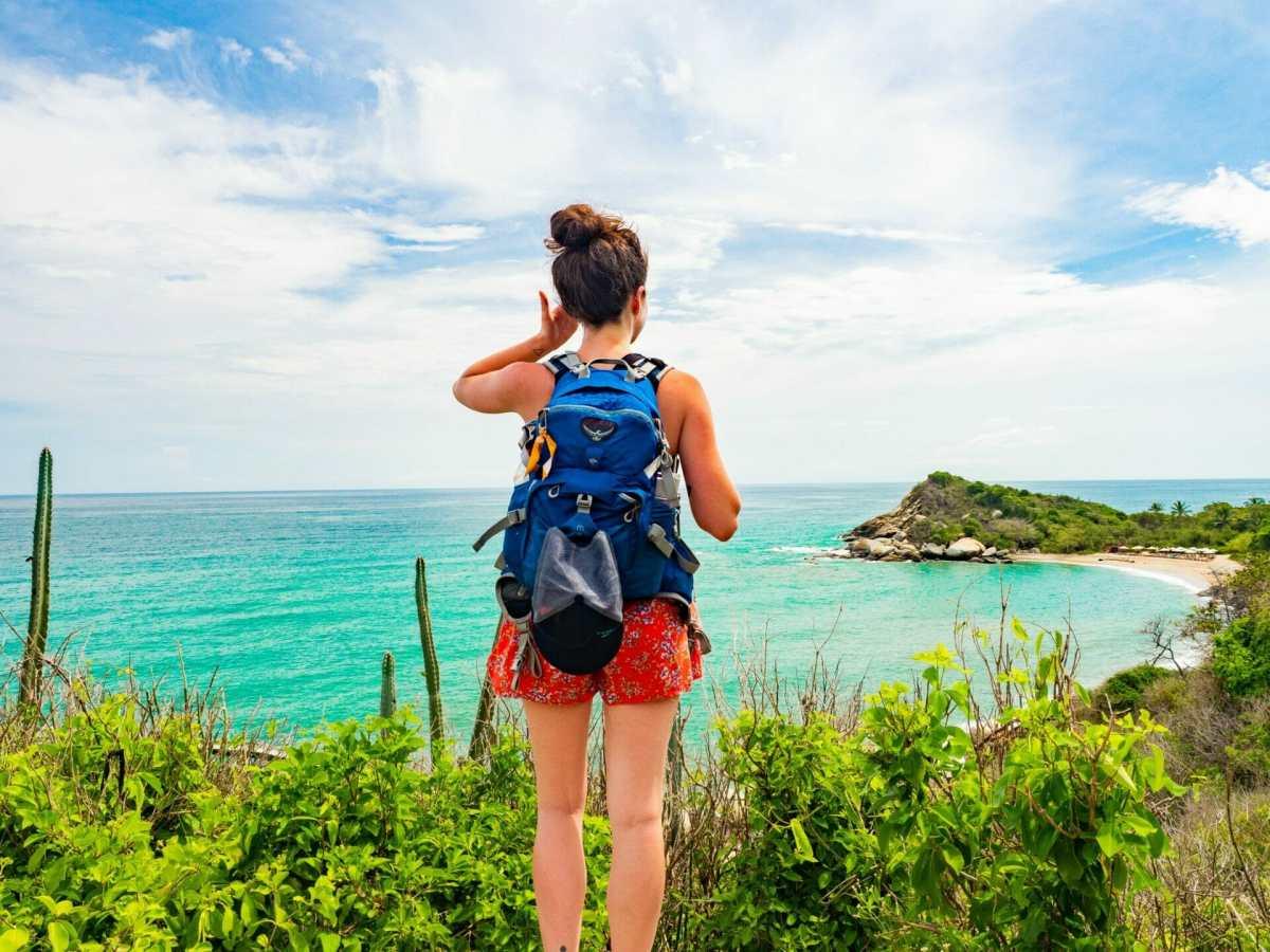 Girl hiking backpack beach Tayrona National Park Colombia