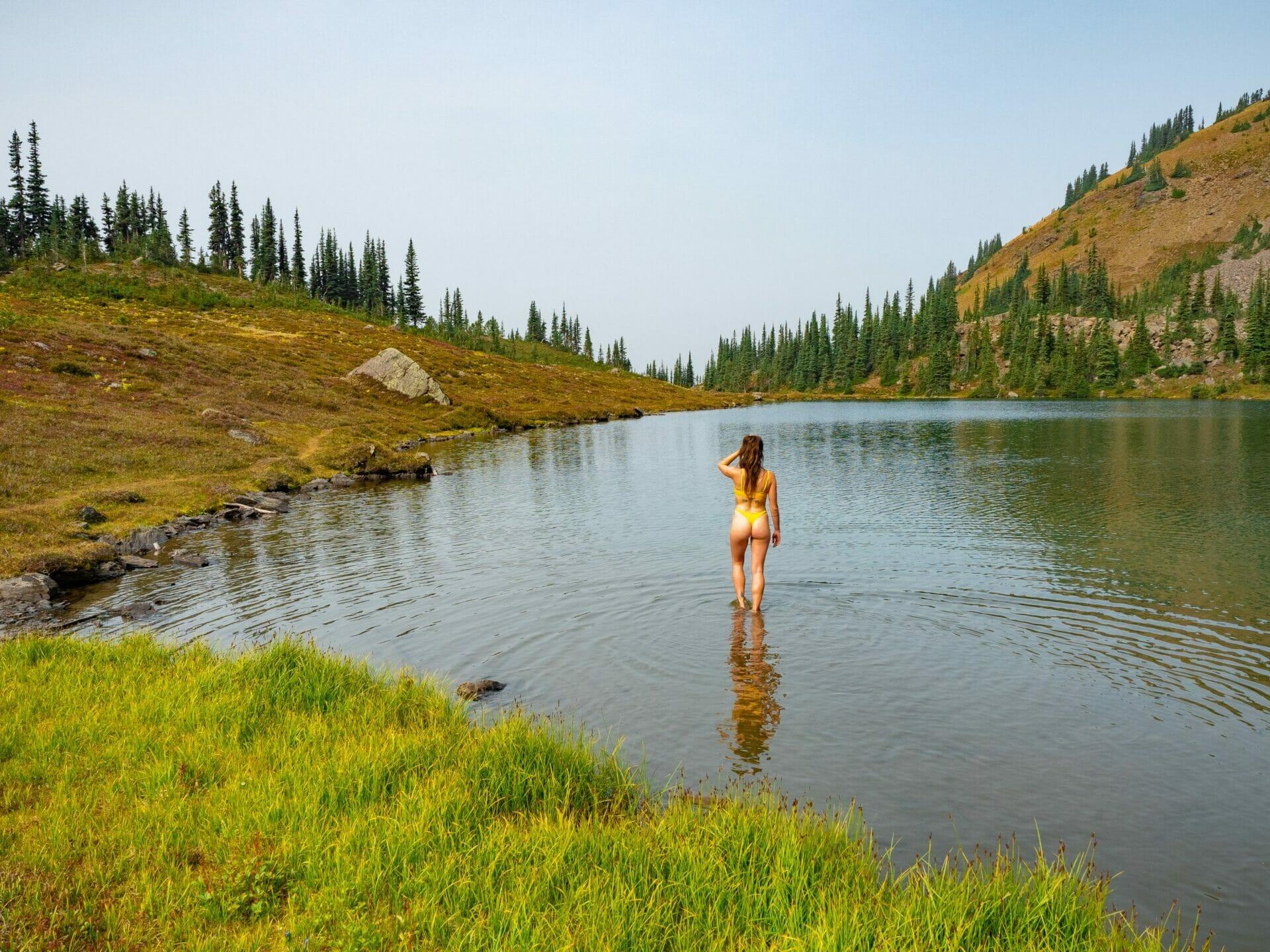 girl swimming lake bikini Alpine Lakes Wilderness