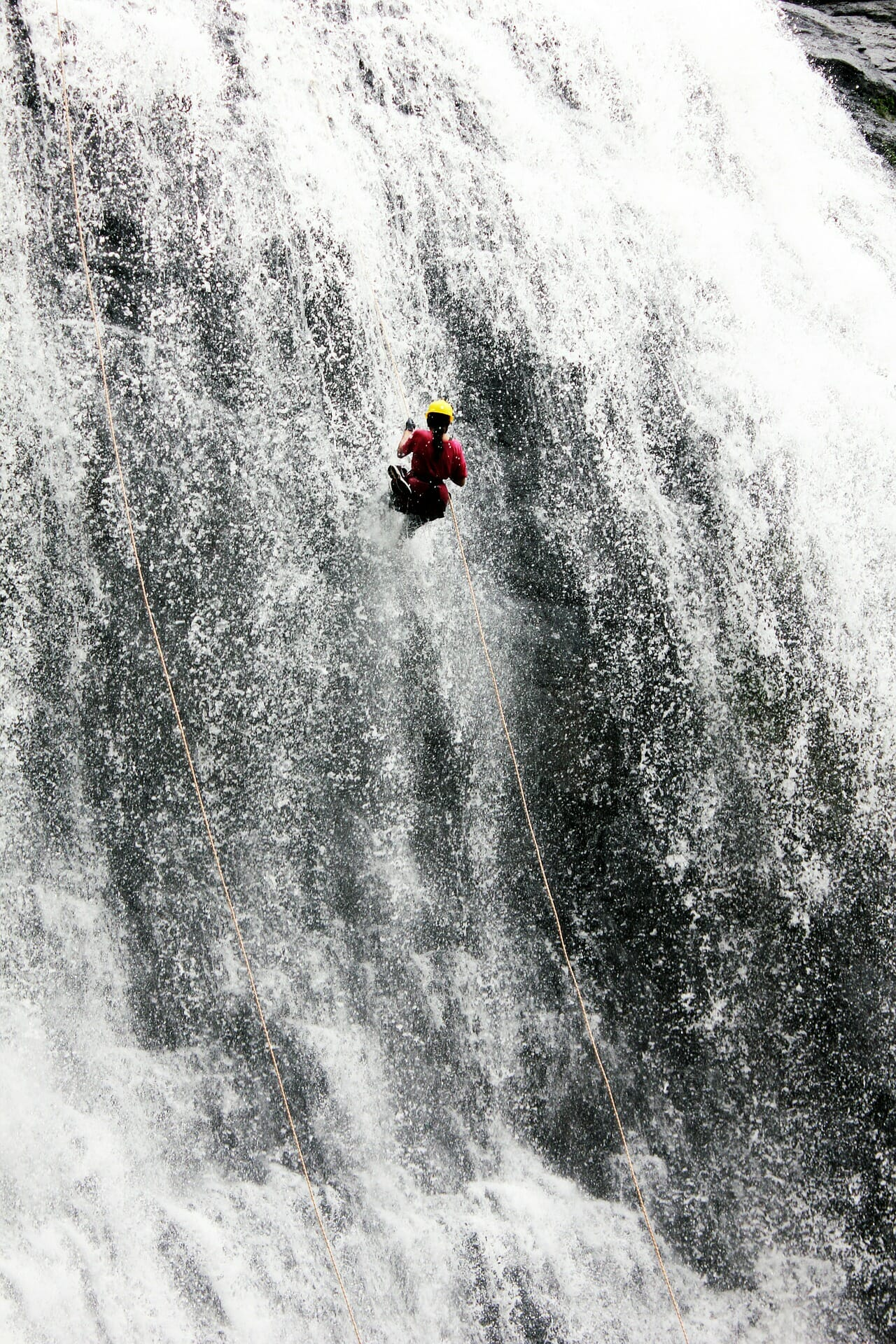 Abseiling down waterfall torrentismo