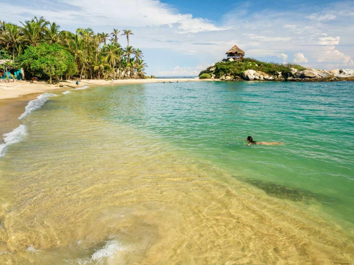 Girl swimming El Mirador, Cabo San Juan beach Parque Tayrona