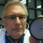 Forms for your first visit are an important part of your exam. Photo of Dr. Lubkeman holding a stethoscope.