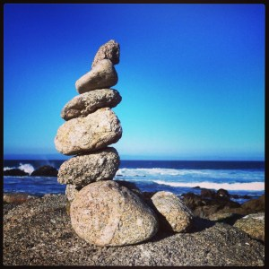 rock cairn with ocean backdrop