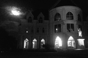 Catholic University building at nighttime