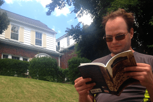 Dan reading Brookland history book at Sterling Brown's House