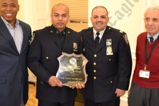 Borough President Eric Adams with the 84th Precinct's 2013 Cop of the Year Saief Hasnain, Captain Maximo Tolentino, and Community Council President Leslie Lewis. - Brooklyn Archive