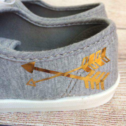 gold arrow shoes